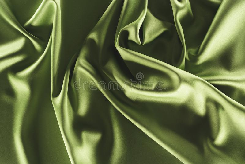 Close up view of elegant green silk cloth. As backdrop stock photo