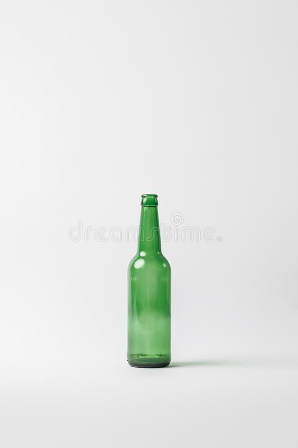 Close up view of empty glass bottle isolated on grey, recycling concept royalty free stock photo
