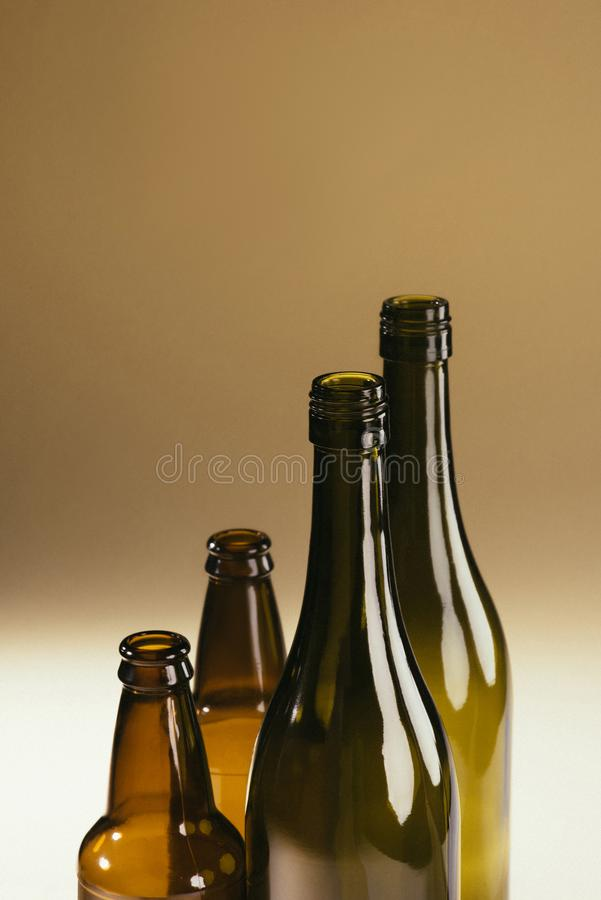 Close up view of empty glass bottles. On dark backrop royalty free stock image