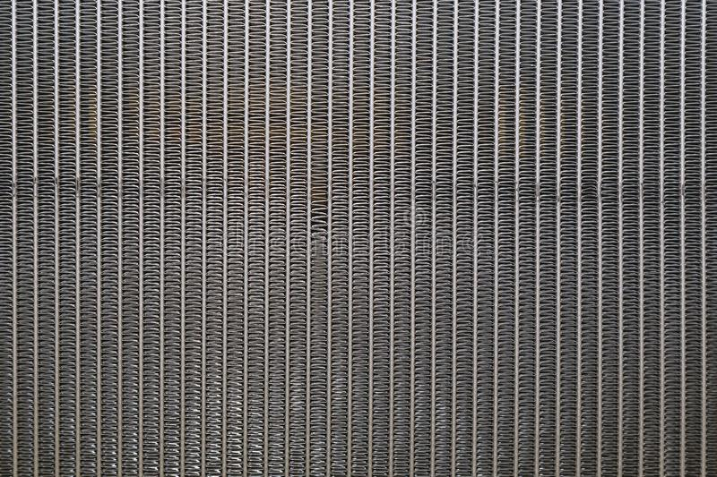 Close-up view of engine cooling radiator background stock image