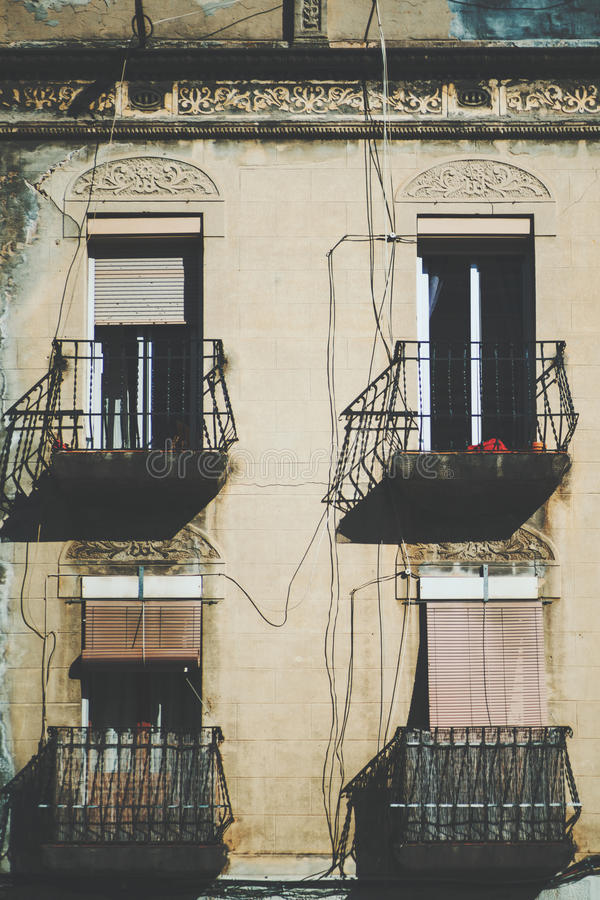 Close-up view of facade with balconies and four windows stock images