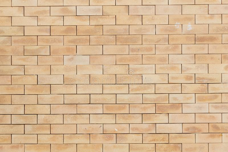 Closeup view of  orange brick wall or floor background textured. Close up view of  fade orange brick wall or floor background textured stock image