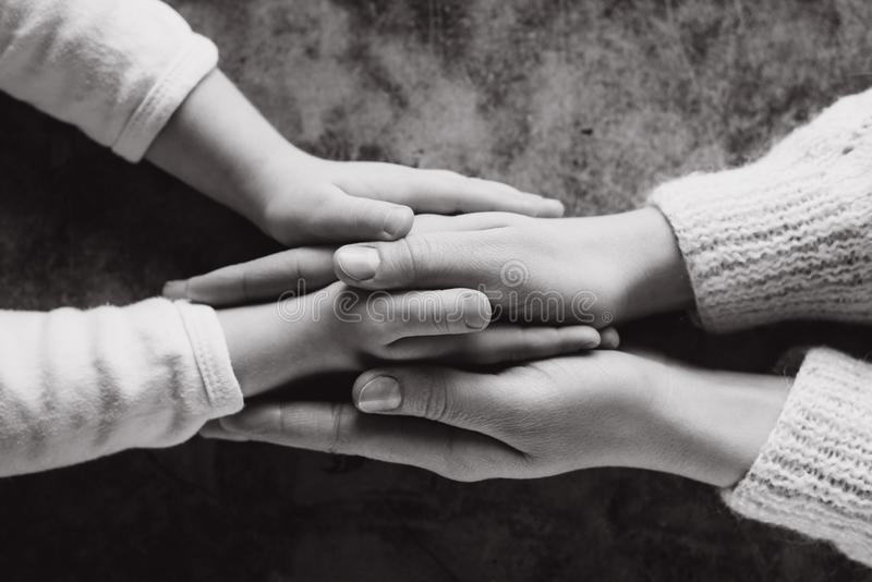 Close up view of family holding hands, loving caring mother supporting child. Helping hand and hope concept royalty free stock image