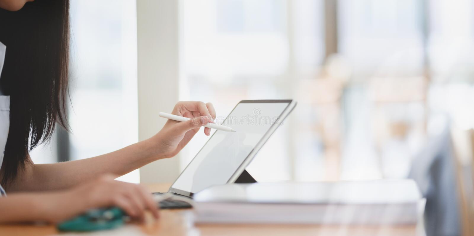 Close-up view of female doctor summarise her patient chart on tablet. Close-up view of female doctor summarise her patient chart on digital tablet royalty free stock photography