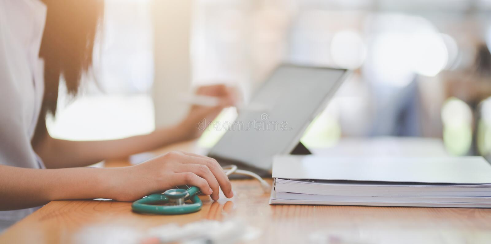 Close-up view of female doctor summarise her patient chart on tablet. Close-up view of female doctor summarise her patient chart on digital tablet stock photography