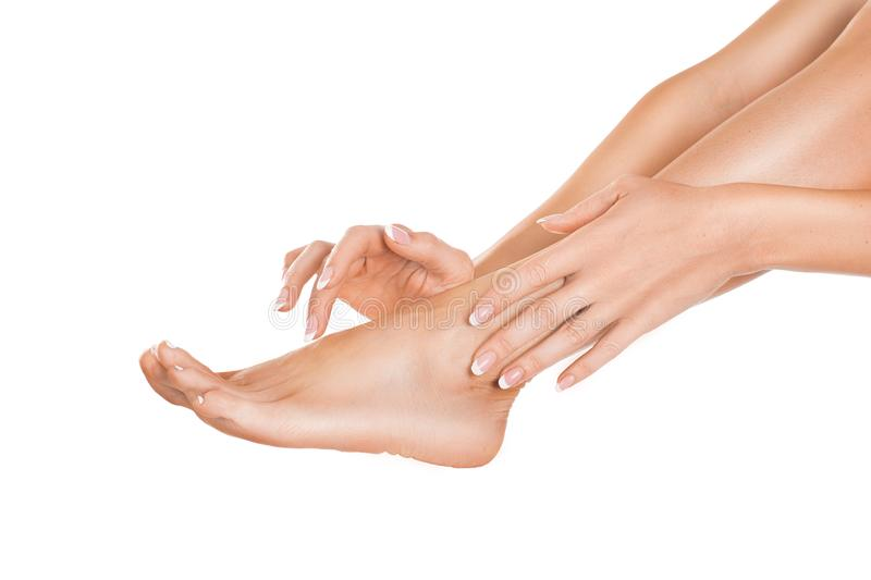 Close up view of a female leg and hands. Skin care concept royalty free stock photography