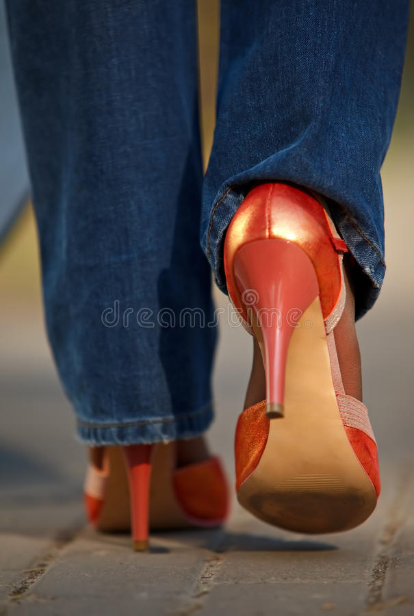 Close-up view of female in red shoes walking royalty free stock photo
