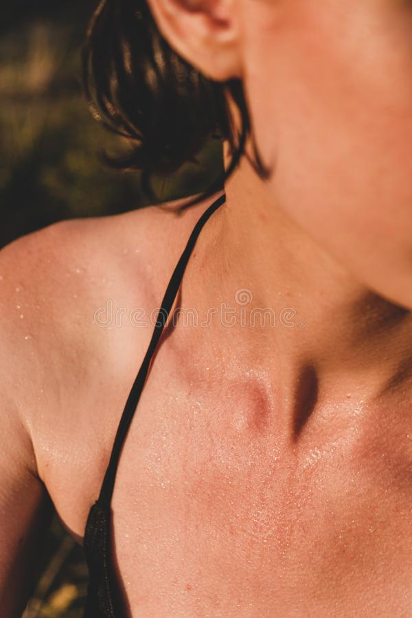 Female skin wet and with goosebumps from swimming in cold water. stock image