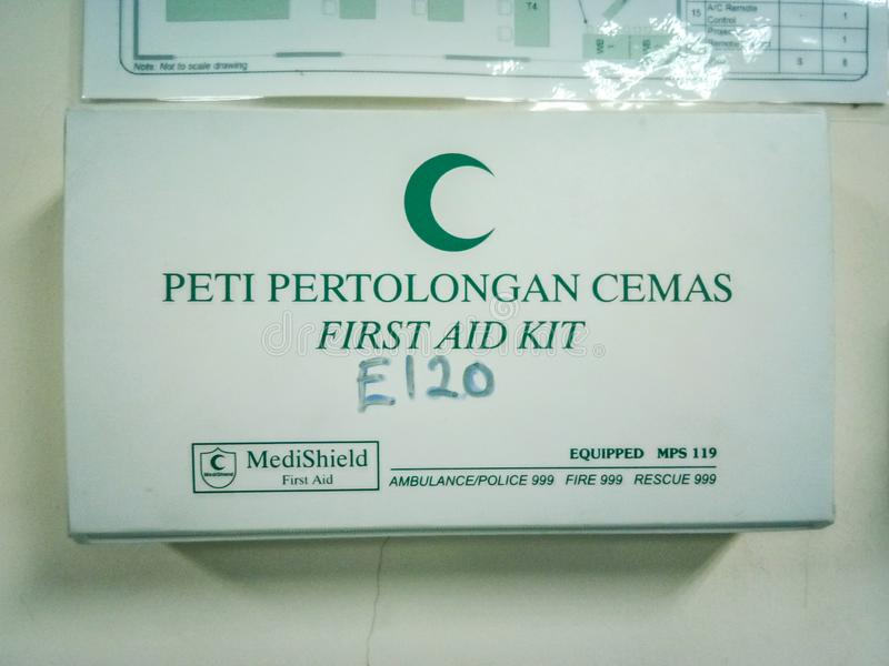 The close up view of the first aid kit from MediShield attached to the wall in the laboratory. Usually used for emergency injury t royalty free stock photos