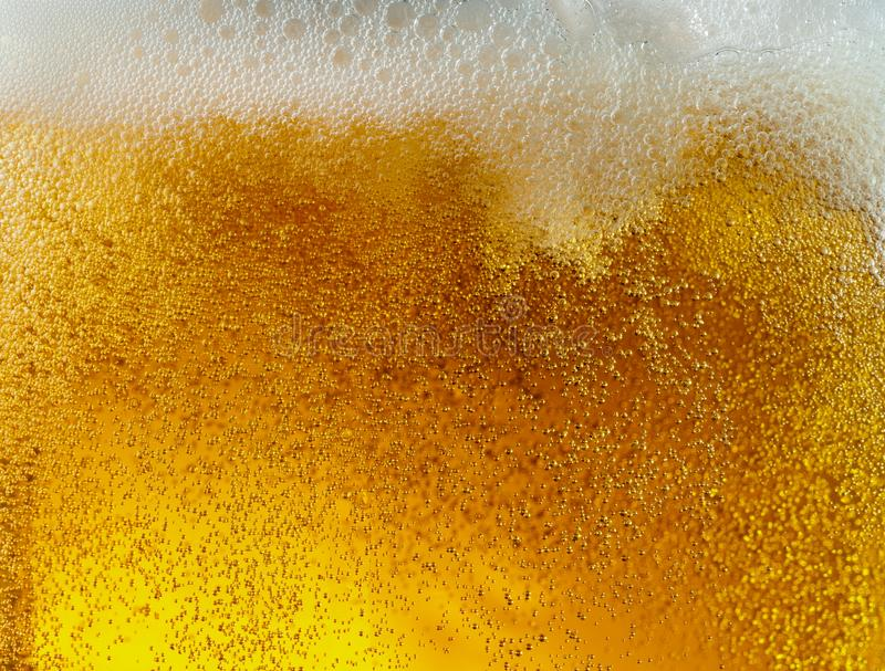 Close up view of floating bubbles in light beer texture stock photo