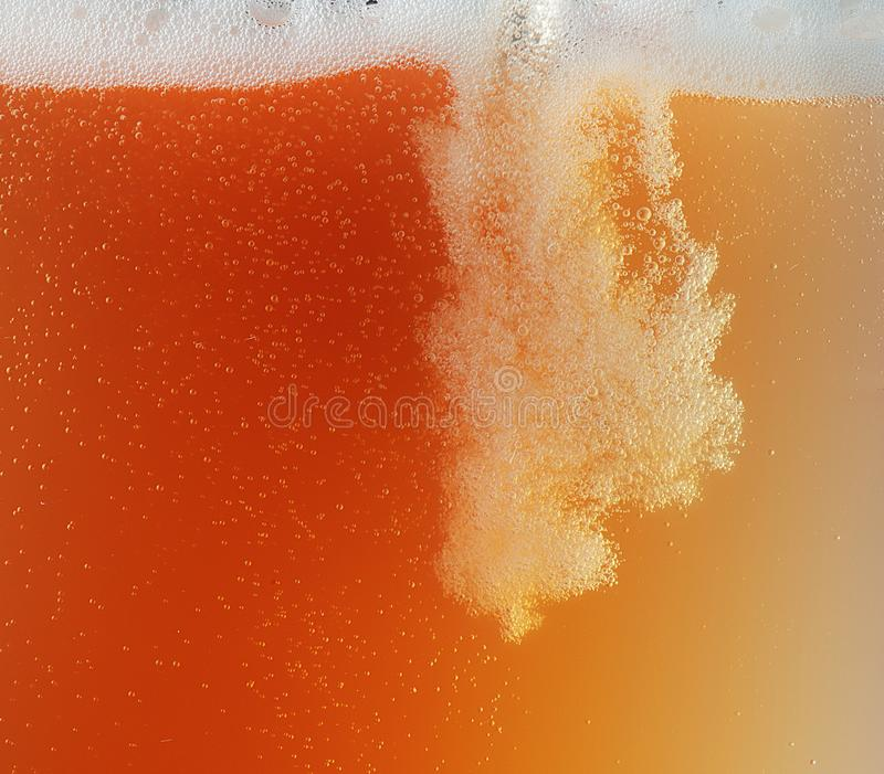 Close up view of floating bubbles in unfiltered beer texture royalty free stock photo
