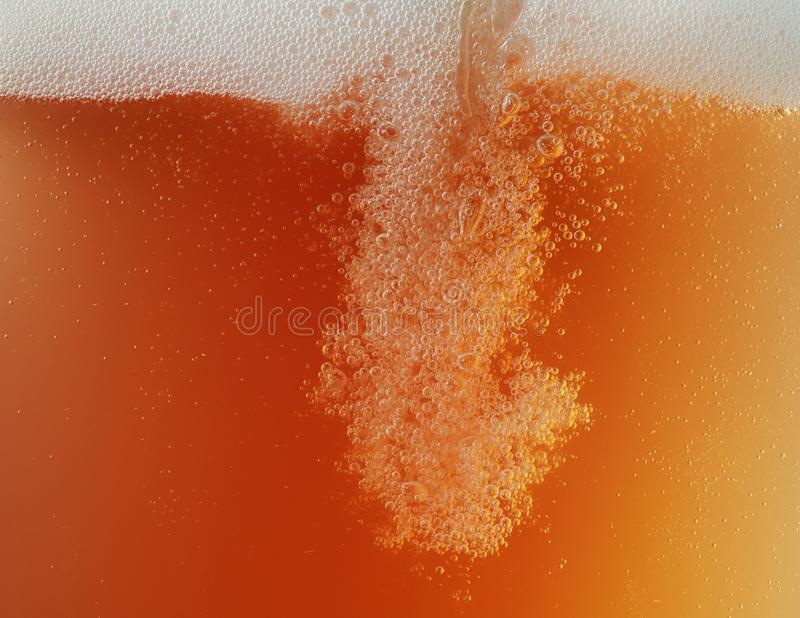 Close up view of floating bubbles in unfiltered beer texture royalty free stock photos