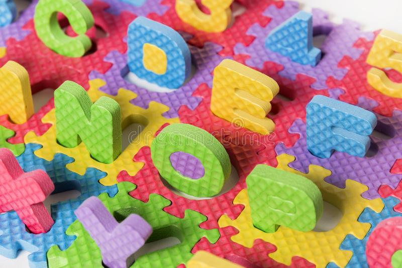 Foam puzzle letter uppercase royalty free stock photo