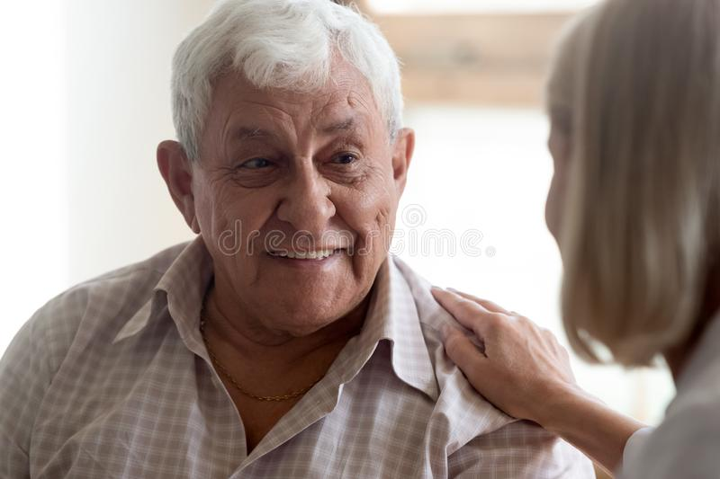 Close up view focus on elderly patient communicates with nurse. Close up view focus on positive elderly 80s man patient communicates with nurse, woman medical stock images