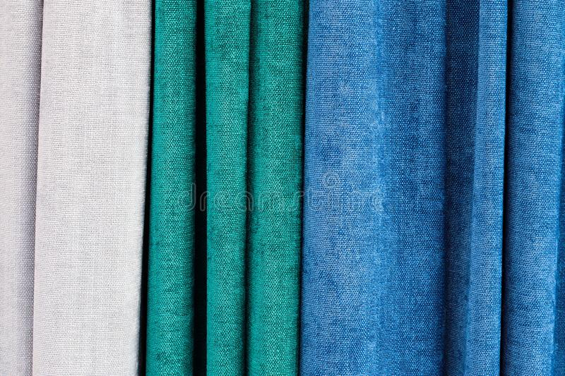 Close up view on folded cloth and fabric textures in different colors royalty free stock photos
