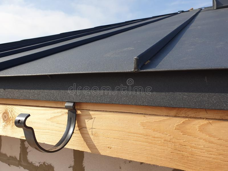 close up view of folded roof of house under construction with holders for gutters water drainage system royalty free stock photos