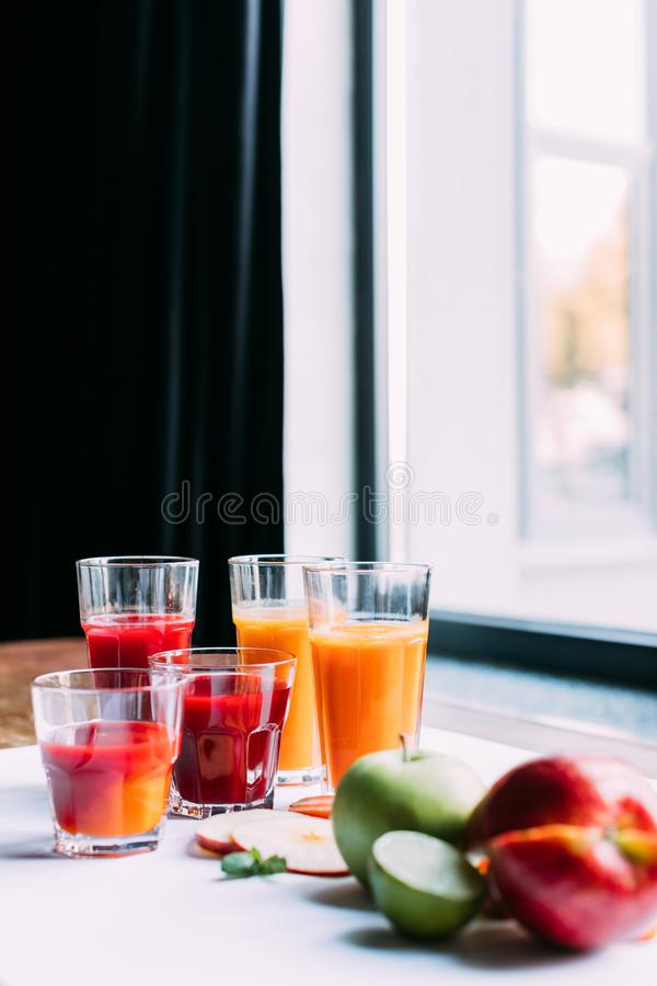 Close-up view of fresh fruit and vegetable smoothies in glasses. On table royalty free stock images