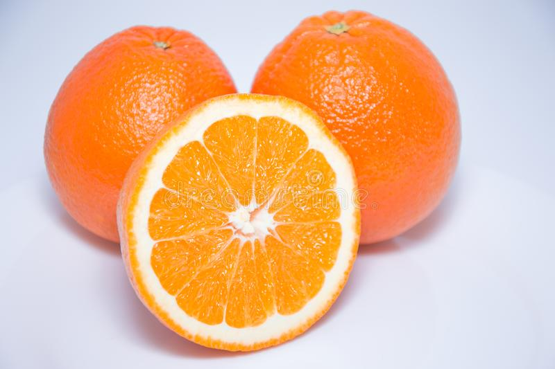 Close-up view of fresh oranges on white background. royalty free stock image