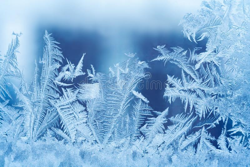 Close up view of a frosty pattern on the glass. Window. Abstract, background stock images