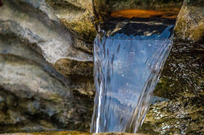 Water Feature. A close up view of a garden water feature cascading down royalty free stock photos