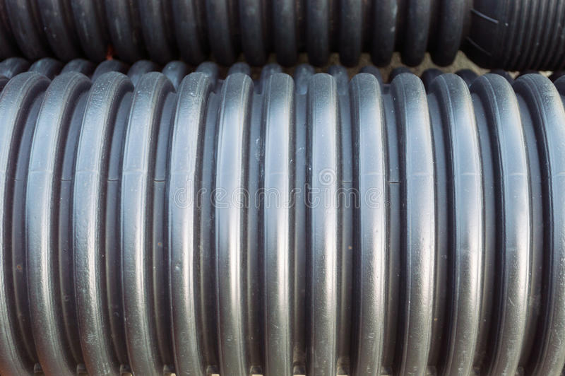 Close up view of garnered black plastic substructure pipes stock photo