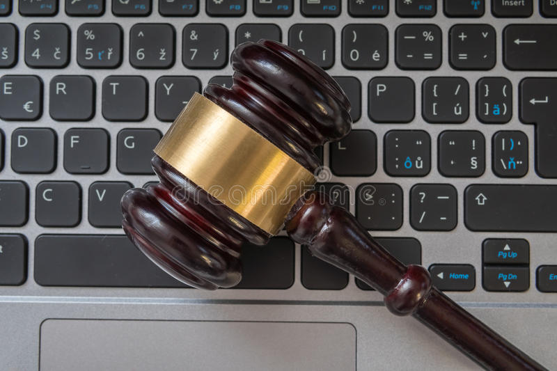 Close up view on gavel and computer keyboard. Internet security laws concept stock images