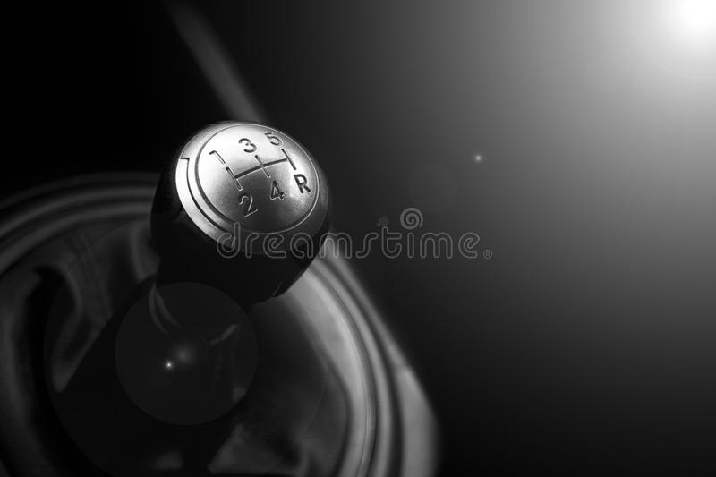 Close up view of a gear lever shift. Manual gearbox. Car interior details. Car transmission. Soft lighting. Abstract view. Black and white royalty free stock image