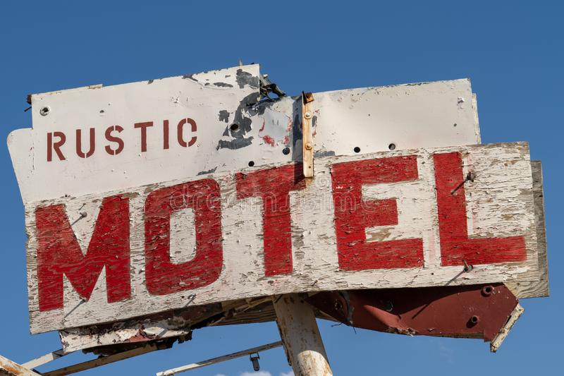 Generic rustic motel sign is decaying and abandoned in California stock images