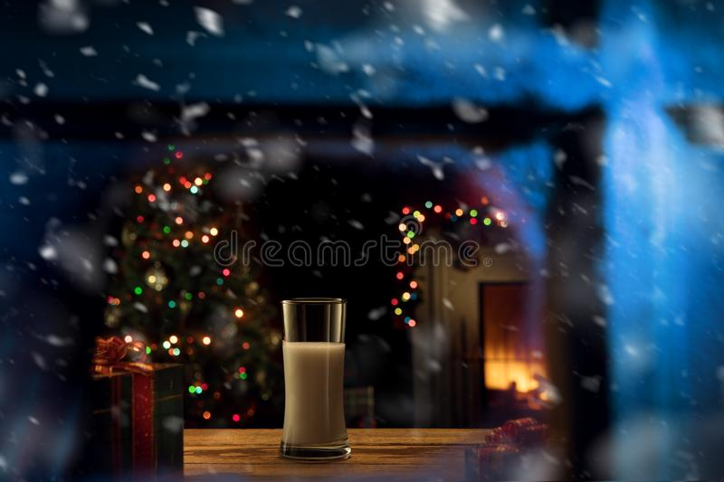 Glass of milk for santa  on color back royalty free stock photography