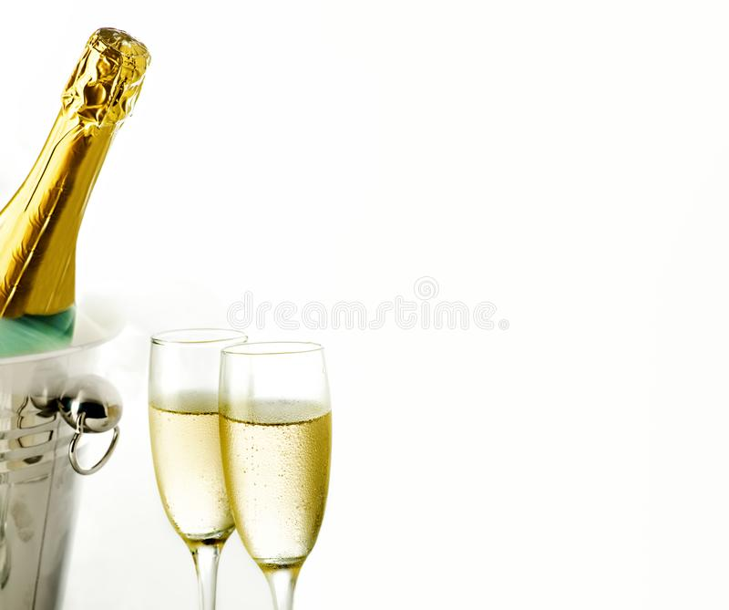 Close up view of glasses and champagne bottle in ice bucket stock photo