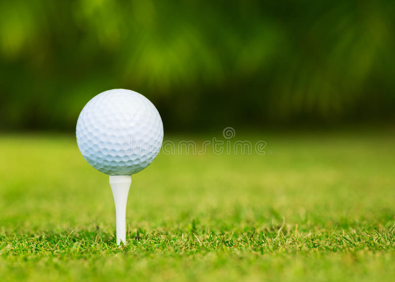 Close up view of golf ball on tee stock photos