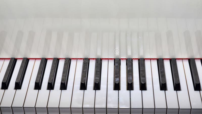 Close Up view of a grand piano white keyboard. Close Up view of a grand piano with white keyboard stock image