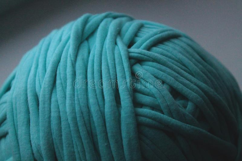 Close up view of green clew thread for knitting stock photos