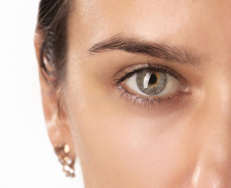 Close up view of a green woman eye royalty free stock photo