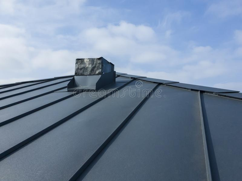 close up view of grey folding roof and chimney on waterproofing layer of house under construction royalty free stock images