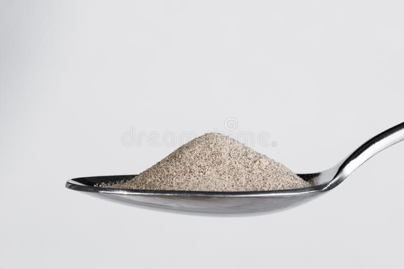 Ground White Pepper on a Spoon. Close up view of ground white pepper on a spoon stock photos