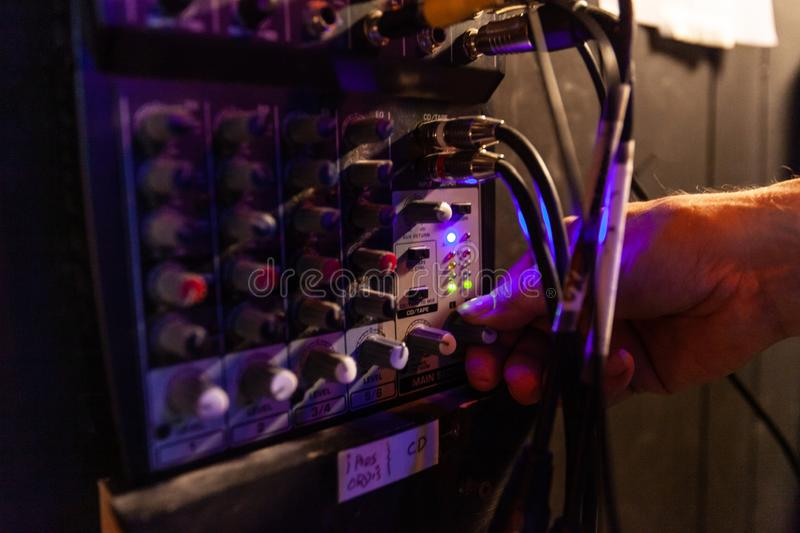 Sound engineer using equipment at work. royalty free stock photography