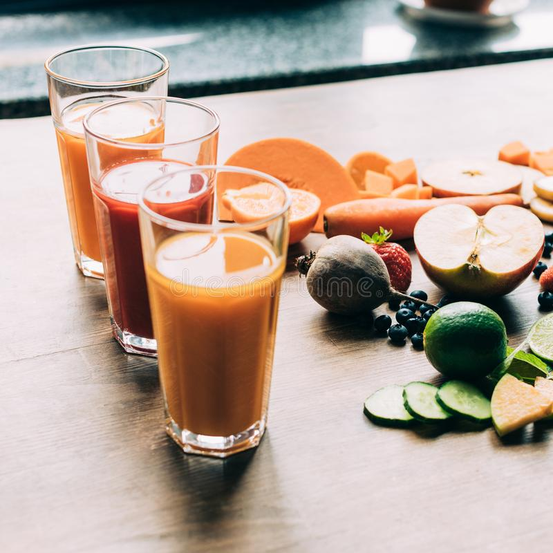 Close-up view of healthy natural smoothies in glasses and fresh ingredients. On table stock photos