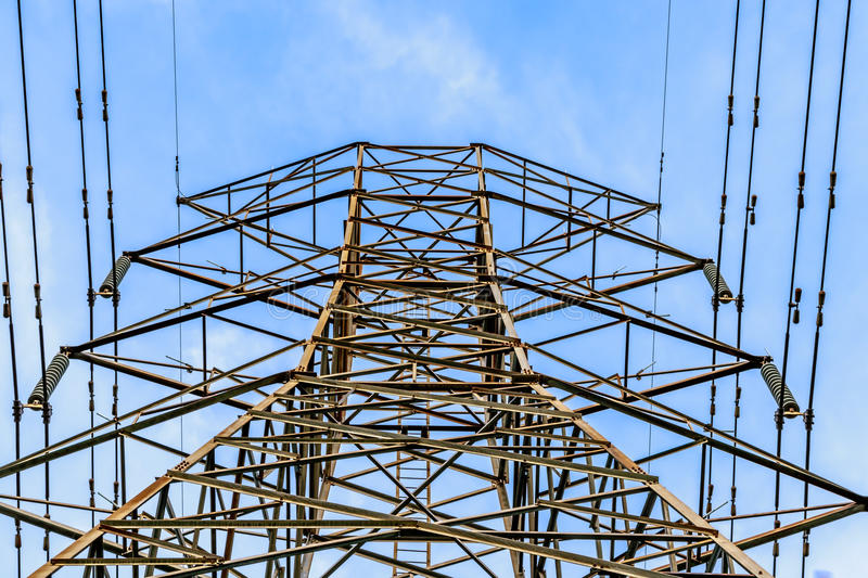 Close up view of high voltage tower with cables stock image
