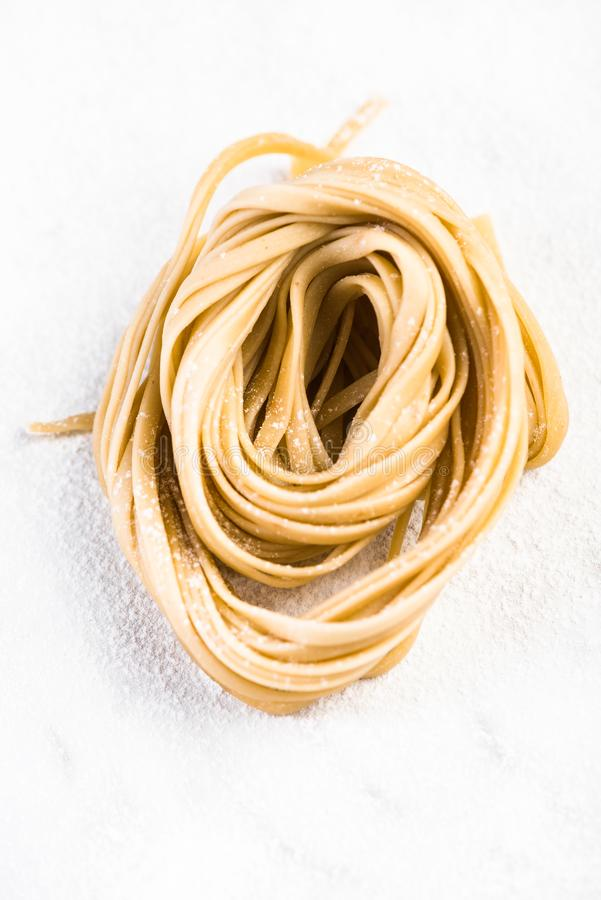 Close up view on homemade raw italian pasta nest royalty free stock images
