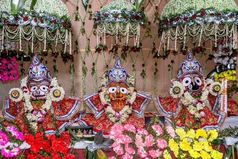 Idols of Hindu God Jagannath, Balaram and Goddess Subhadra Beautifully decorated during the Rath Yatra Festival. Close up view of Idols of Hindu God Jagannath stock photo