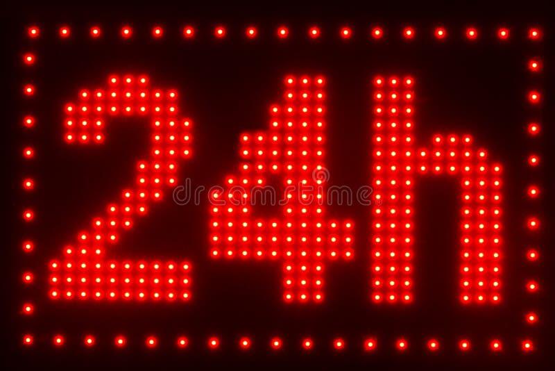 close up view of illuminated twenty four hour sign stock illustration