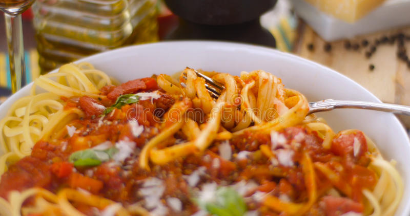 Close up view of Italian pasta spaghetti, linguine with tomato sauce and basil stock image
