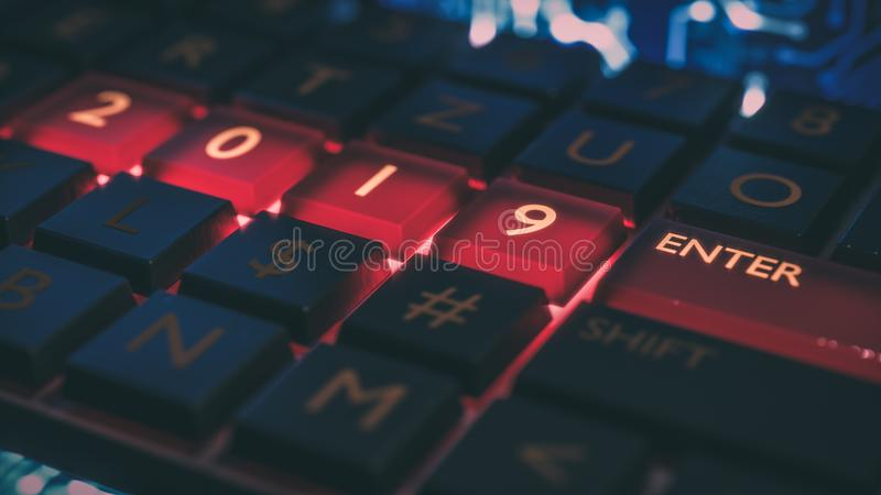 Keyboard with red light on 2019 number and enter key. New year. Close up view of keyboard with red light on 2019 number keys and enter key. Technical concept royalty free stock image