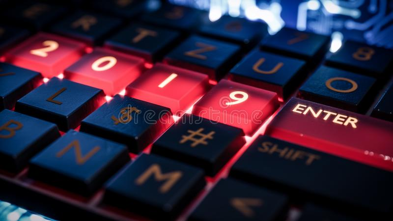 Keyboard with red light on 2019 number and enter key. New year. Close up view of keyboard with red light on 2019 number keys and enter key. Technical concept royalty free stock images