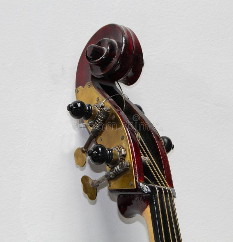The close up view of left side of contrabass head. royalty free stock photos