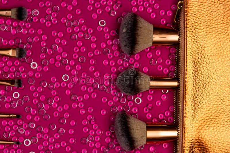 Close up view of makeup brushes and cosmetic bag stock images