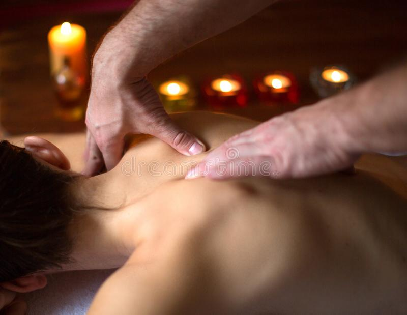 Close up view of a male hands massaging female neck and shoulders. Spa and relax concept royalty free stock photography