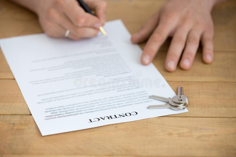 Close up view of male hands sign mortgage contract royalty free stock photography
