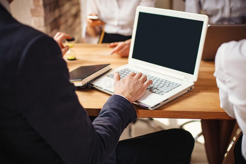 Close-up view of man`s hands working on laptop stock photos